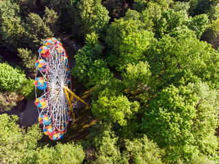 ferris wheel in public park at summer morning. aerial photography
