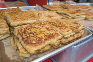 Chicken murtabak selling in the Ramadan bazaar. It is a stuffed pancake or pan-fried bread which is commonly found in Yemen, Saudi Arabia India, Indonesia, Malaysia, Singapore, Brunei, and Thailand.