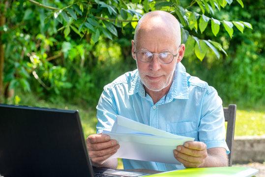 senior man reading the letter