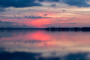Perfectly symmetric reflection of  sunset on a  lake, with warm