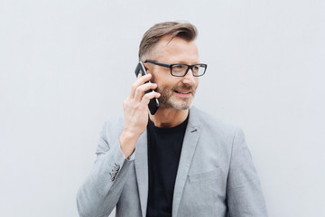 Mature metro man on phone with copy space