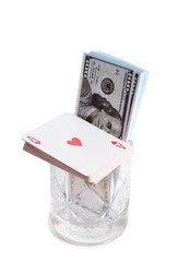 Cards and chips for casino in glass with on white background