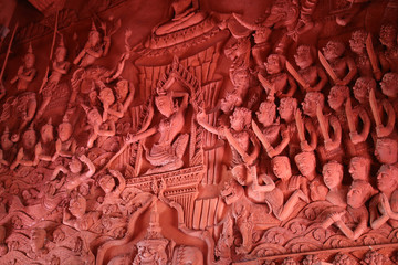 Close-up of giant holding a stick with hanuman armed sculpture wall , in Sila Ngu Temple, Koh Samui, Thailand.