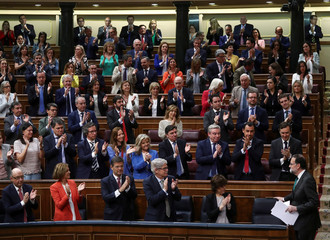 Spain's Prime Minister Mariano Rajoy is applauded by party members during a motion of no confidence debate at Parliament in Madrid