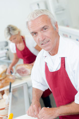 Butcher serving a female customer