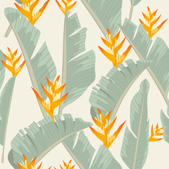 Seamless pattern yellow heliconia flower on banana leaf tropical leaves background.printing wallpaper.vector illustration
