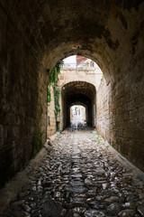 Fototapeta Stone tunnel i old city Polignano mare apulia city street in Italy