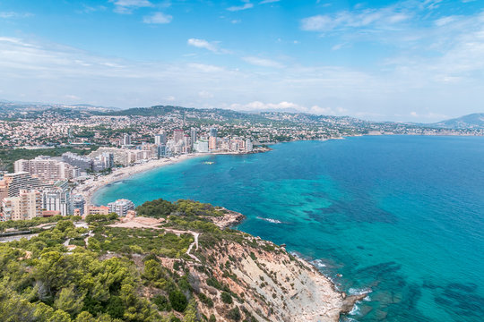 Coast, coastline, in the distance the city. Summer, sunny day. Calpe, Spain.
