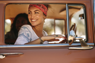 Attractive woman looking outside the car window