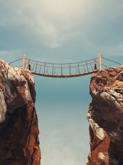 Old bridge over between two big rocks.