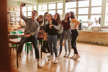 Students in classroom taking selfie