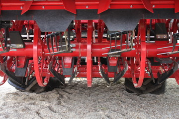 Modern red harvest machine in Agriculture