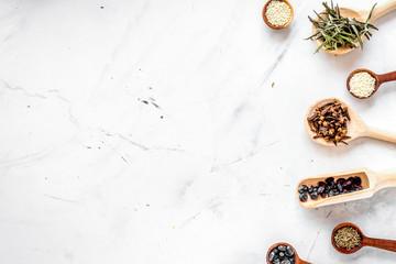 Dry colorful spices, vanilla, cinnamon on kitchen stone table ba