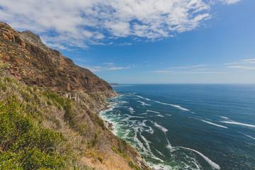 Chapman's Peak Drive along rocky coastal landscape in Cape Town