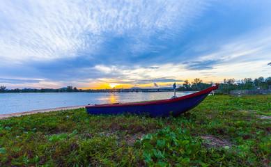 sunrise above Sarasin bridge fishing boats are parking on the beach