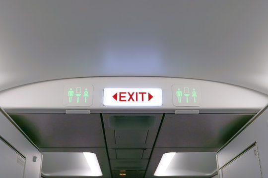 Close up of exit sign in passenger airplane.
