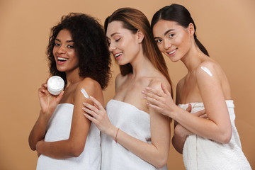 3cdfde49ec Beauty portrait of three young multiracial women with different types of  skin  caucasian