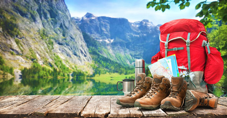 lake landscape with big backpack and trekking boots