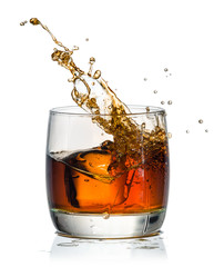 Fototapete - whiskey with splash on white background