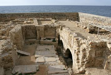 The ruin of the medieval church on the coast of Mediterranean sea in Heraklion, Crete, Greece.