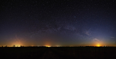 Space with the stars of the Milky Way in the night sky. Panoramic view is photographed on long exposure.