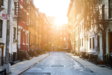 Sunlight shines on historic buildings along Gay Street in Greenwich Village neighborhood of Manhattan in New York City