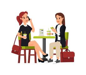 Two beautiful business women sitting