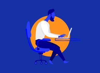 Ragazzo alla moda che lavora al computer