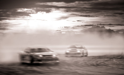 Car battle drifting, Blurred of image diffusion race drift car with lots of smoke from burning tires on speed track.