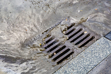 Rain flowing into a storm water sewer system