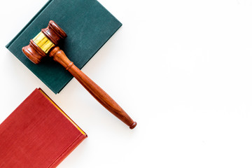 Law student concept. Judge gavel and vintage books on white background top view copy space