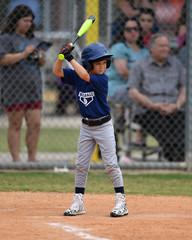 Young boy playing youth baseball