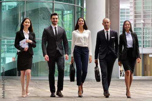 A Group Of Business People Of Different Ethnicities Dressed In Suits
