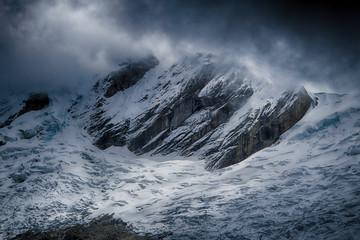 Mount Taulliraju in clouds (Peru)