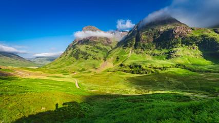 Beautiful sunrise and tiny shadow of man, Glencoe, Scotland