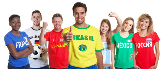 Optimistic brazilian soccer supporter with fans from other countries