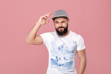 bearded man in cap smiling