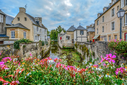 The picturesque French town of Bayeux France near the coast of Normandy with it's medieval houses overlooking the River Aure on an overcast day