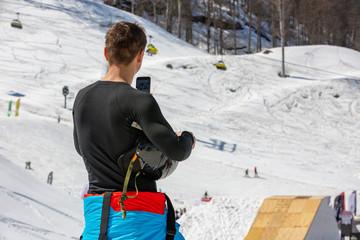 skier makes a photo of mountain scenery