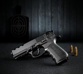 Hand Gun and Bullets atthe Shooting Range