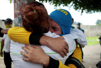 A demonstrator embraces his mother during a protest against Nicaraguan President Daniel Ortega's government in Managua