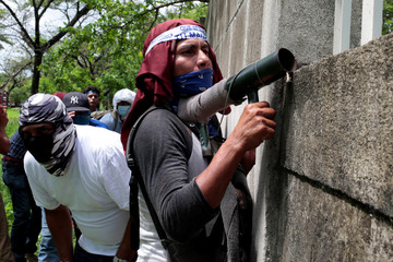 A demonstrator prepares his homemade mortar during a protest against Nicaraguan President Daniel Ortega's government in Managua