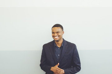 Millennial man laughing