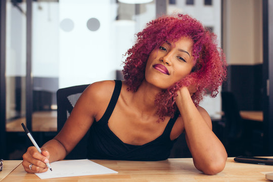 Young woman writing at desk