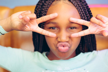 Teen girl making a face with hand gestures