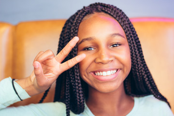 Teen girl smiling with hand gesture