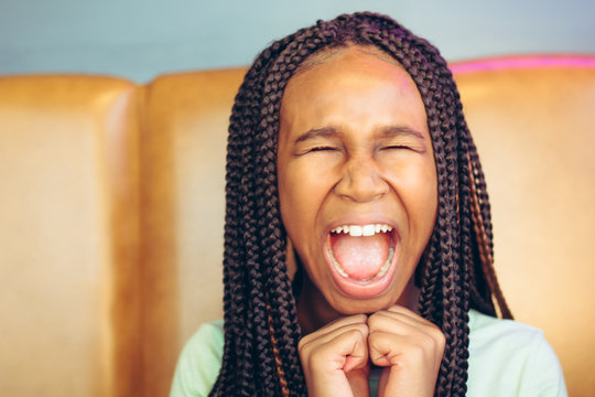 Close up of teenage girl making funny faces