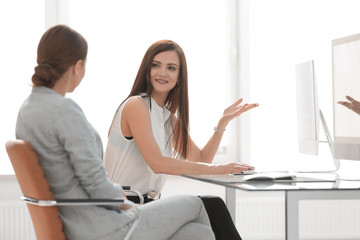 two office workers talking in the workplace