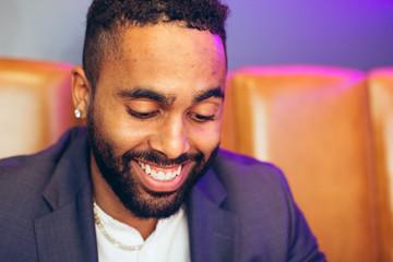 Millennial businessman smiling