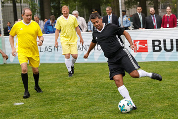 Former soccer player Pavel Pardo kicks a ball on a pitch on the North Lawn during a German-sponsored event at the United Nations headquarters promoting positive impact of the sport ahead of the World Cup, in Manhattan